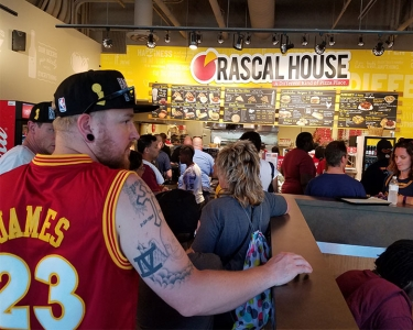 customers in line ordering at Rascal House pizza