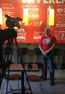Niko Frangos owner of Rascal House Pizza on camera